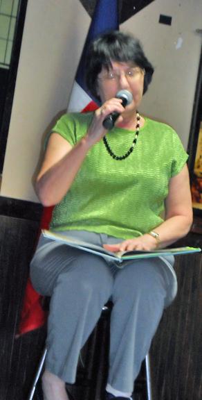 Vice President Sheila Balagna read from a children's book.