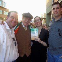 Flag Carriers Brendan Smith and Marcus Blake, with James Joyce book presentation by Leo Crowley to Brendan and Erin Smith.